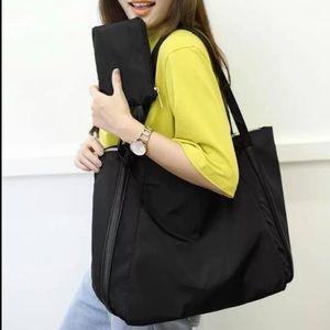 2️⃣2/50 Classic black satin leather trim tote bag